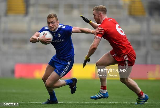 Dublin Ireland 12 August 2018 Colin Walshe of Monaghan in action against Frank Burns of Tyrone during the GAA Football AllIreland Senior Championship...