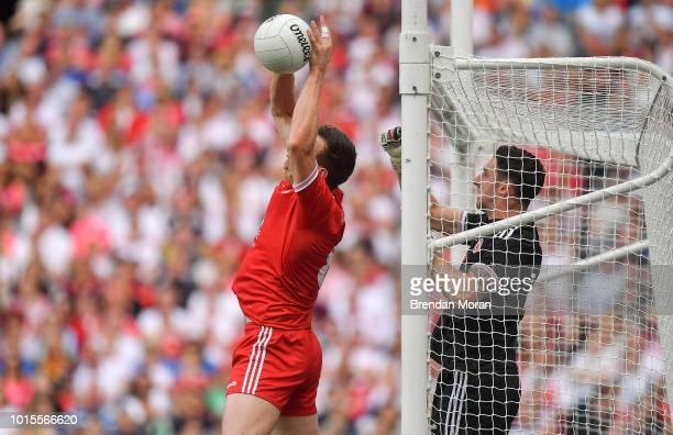 Dublin Ireland 12 August 2018 Colm Cavanagh of Tyrone saves a shot ahead of teammate Niall Morgan during the GAA Football AllIreland Senior...