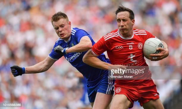 Dublin Ireland 12 August 2018 Colm Cavanagh of Tyrone shoulders Ryan McAnespie of Monaghan during the GAA Football AllIreland Senior Championship...