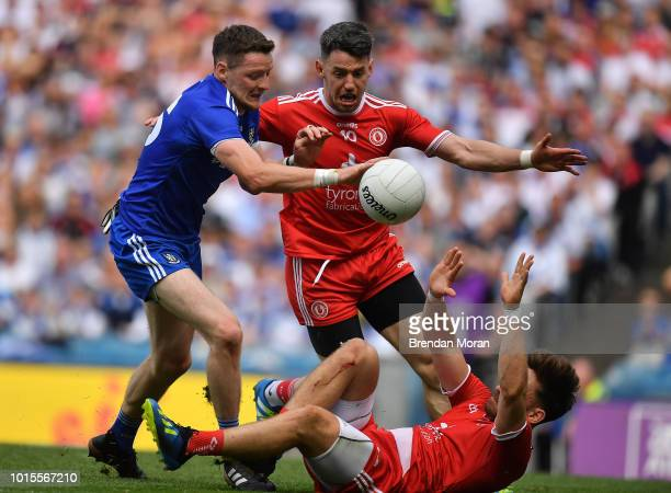 Dublin Ireland 12 August 2018 Conor McManus of Monaghan in action against Mattie Donnelly and Padraig Hampsey of Tyrone during the GAA Football...