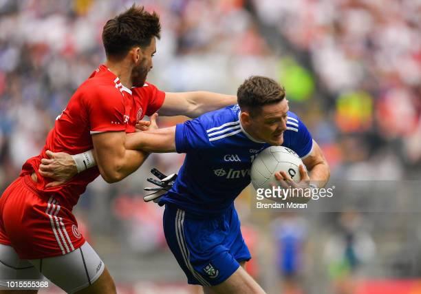 Dublin Ireland 12 August 2018 Conor McManus of Monaghan is tackled by Padraig Hampsey of Tyrone during the GAA Football AllIreland Senior...