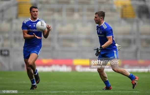 Dublin Ireland 12 August 2018 Dermot Malone of Monaghan right handpasses the ball to teammate Ryan Wylie during the GAA Football AllIreland Senior...