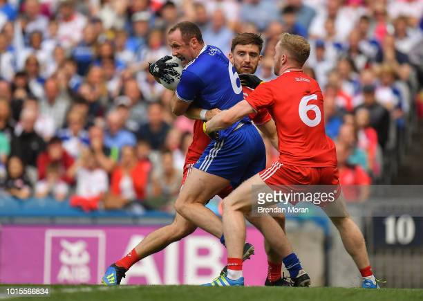 Dublin Ireland 12 August 2018 Vinny Corey of Monaghan is tackled by Padraig Hampsey and Frank Burns of Tyrone during the GAA Football AllIreland...