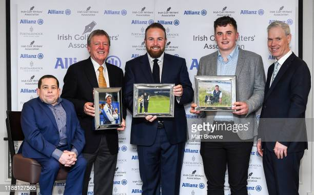 Dublin Ireland 12 December 2019 Shane Lowry with the The Irish Golf Writers Association Professional Player of the Year award for 2019 with from left...
