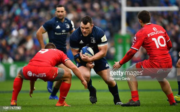 Dublin Ireland 12 January 2019 Cian Healy of Leinster is tackled by Antoine Dupont left and Thomas Ramos of Toulouse during the Heineken Champions...