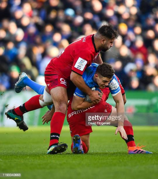 Dublin Ireland 12 January 2020 Garry Ringrose of Leinster is tackled by Hamza Kaabèche left and Francisco Gomez Kodela of Lyon during the Heineken...