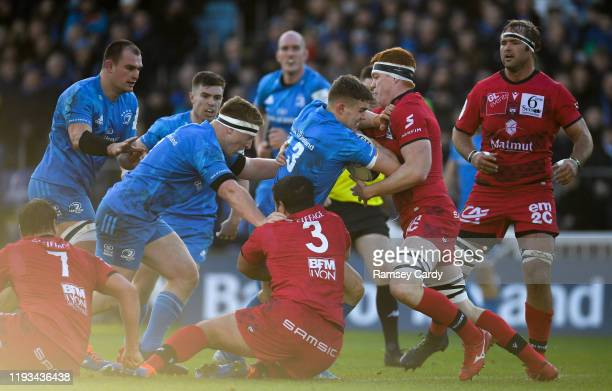 Dublin Ireland 12 January 2020 Garry Ringrose of Leinster is tackled by Felix Lambey of Lyon during the Heineken Champions Cup Pool 1 Round 5 match...