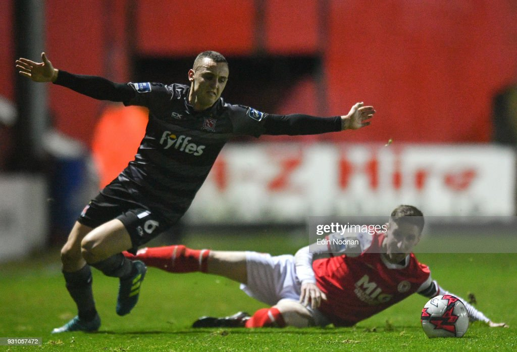 Dublin , Ireland - 12 March 2018; Dylan Connolly of Dundalk is tackled by Ian Bermingham of St Patrick's Athletic during the SSE Airtricity League Premier Division match between St Patrick's Athletic and Dundalk at Richmond Park in Dublin.