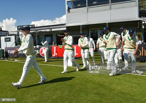Dublin Ireland 12 May 2018 Ireland captain William Porterfield left leads his side out prior to play on day two of the International Cricket Test...