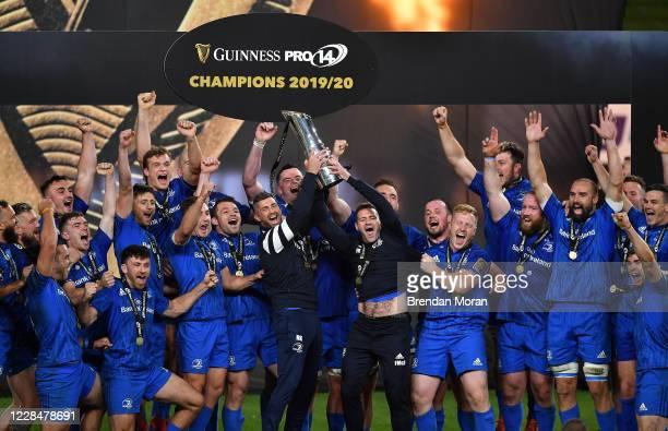 Dublin , Ireland - 12 September 2020; Rob Kearney, left, and Fergus McFadden, right, of Leinster lift the PRO14 trophy alongside their team-mates...