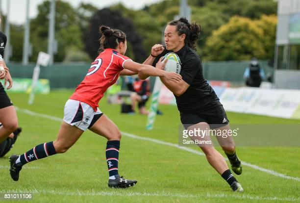 Dublin , Ireland - 13 August 2017: Portia Woodman of New Zealand is tackled by Jessica Ho of Hong Kong during the 2017 Women's Rugby World Cup Pool A...