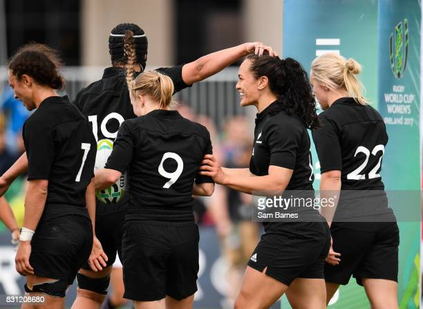 Portia Woodman of New Zealand second from right is congratulated by team mates after scoring a try during the 2017 Women's Rugby World Cup Pool A...