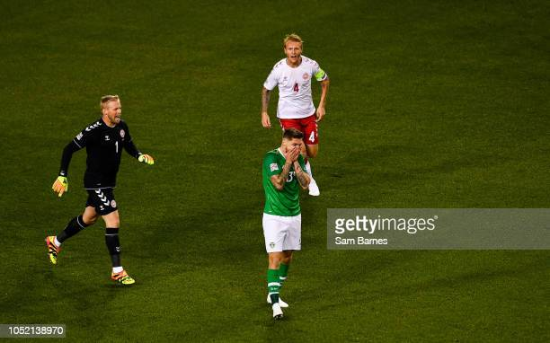 Dublin Ireland 13 October 2018 Jeff Hendrick of Republic of Ireland reacts to a missed chance as Kasper Schmeichel left and Simon Kjær of Denmark...