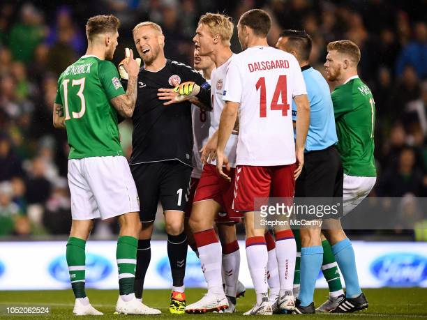 Dublin Ireland 13 October 2018 Kasper Schmeichel of Denmark confronts Jeff Hendrick of Republic of Ireland during the UEFA Nations League B group...