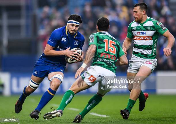 Dublin Ireland 14 April 2018 Max Deegan of Leinster is tackled by Jayden Hayward of Benetton Rugby during the Guinness PRO14 Round 20 match between...