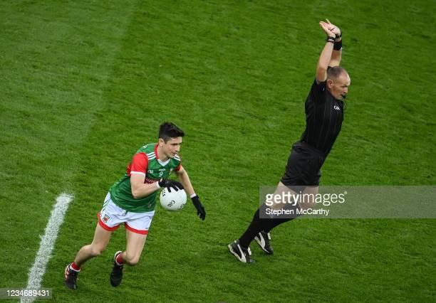 Dublin , Ireland - 14 August 2021; Referee Conor Lane avoids Conor Loftus of Mayo during the GAA Football All-Ireland Senior Championship semi-final...