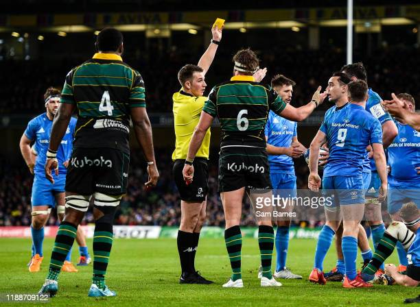 Dublin , Ireland - 14 December 2019; Referee Daniel Jones shows Tom Wood of Northampton Saints a yellow card during the Heineken Champions Cup Pool 1...