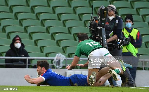 Dublin , Ireland - 14 February 2021; Damian Penaud of France scores his side's second try despite the tackle of Hugo Keenan of Ireland during the...