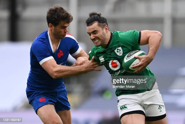Dublin , Ireland - 14 February 2021; James Lowe of Ireland is tackled by Matthieu Jalibert of France during the Guinness Six Nations Rugby...