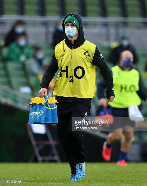 Dublin , Ireland - 14 February 2021; Jonathan Sexton of Ireland acting as a water carrier during the Guinness Six Nations Rugby Championship match...