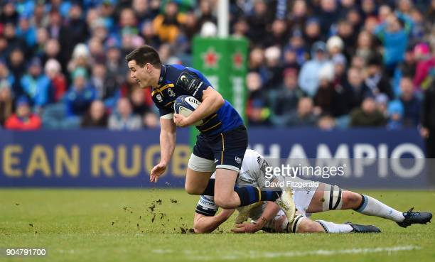 Dublin Ireland 14 January 2018 Jonathan Sexton of Leinster is tackled by Matt Smith of Glasgow Warriors during the European Rugby Champions Cup Pool...