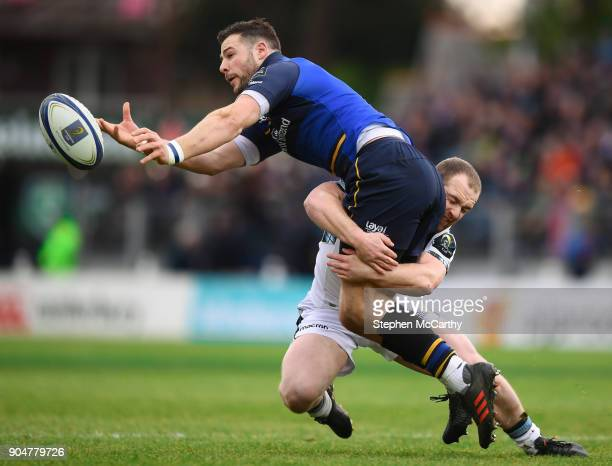 Dublin Ireland 14 January 2018 Robbie Henshaw of Leinster is tackled by Nick Grigg of Glasgow Warriors during the European Rugby Champions Cup Pool 3...