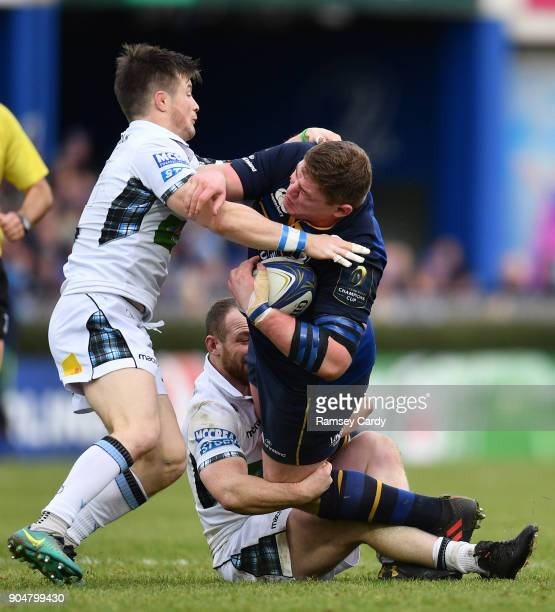 Dublin Ireland 14 January 2018 Tadhg Furlong of Leinster is tackled by George Horne left and Nick Grigg of Glasgow Warriors during the European Rugby...
