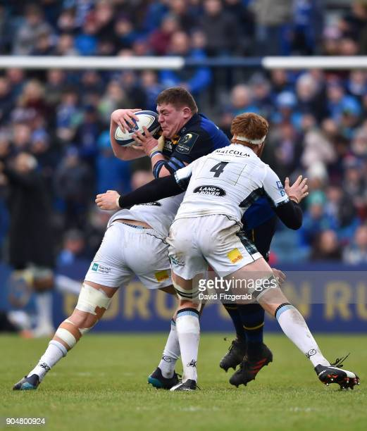 Dublin Ireland 14 January 2018 Tadhg Furlong of Leinster is tackled by Rob Harley right and Greg Peterson of Glasgow Warriors during the European...
