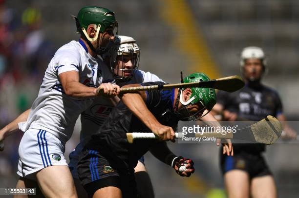 Dublin Ireland 14 July 2019 James Barry of Tipperary in action against Eanna Lyons left and Aaron Dunphy of Laois during the GAA Hurling AllIreland...