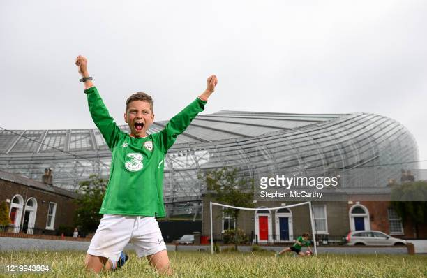 Dublin , Ireland - 14 June 2020; Republic of Ireland supporter and Havleock Square resident Johnny Murphy, age 8, celebrates scoring on his friend...