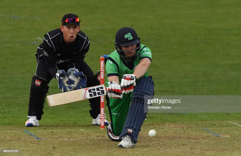 Dublin , Ireland - 14 May 2017; Andrew Balbirnie of Ireland hits a boundary off Mitchell Santner of New Zealand watched by wicketkeeper Luke Ronchi during the One Day International match between Ireland and New Zealand at Malahide Cricket Club in Dublin.
