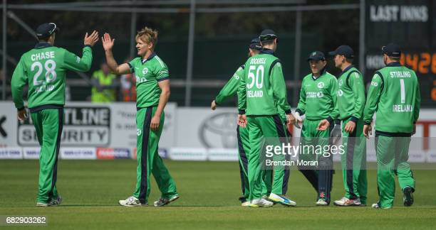 Dublin Ireland 14 May 2017 Barry McCarthy 2nd from left of Ireland celebrates taking the wicket of Luke Ronchi of New Zealand during the One Day...