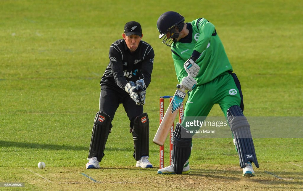 Dublin , Ireland - 14 May 2017; George Dockrell of Ireland hits a single during the One Day International match between Ireland and New Zealand at Malahide Cricket Club in Dublin.