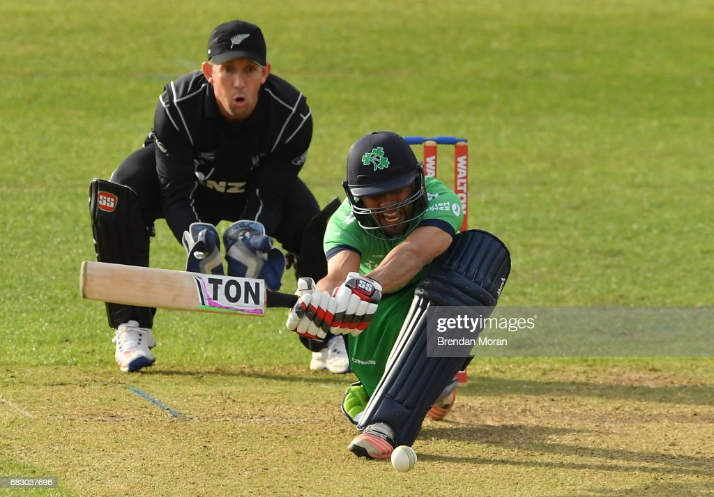 Dublin , Ireland - 14 May 2017; Simi Singh of Ireland hits from a delivery by Mitchell Santner of New Zealand during the One Day International match between Ireland and New Zealand at Malahide Cricket Club in Dublin.