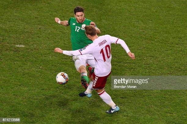 Dublin Ireland 14 November 2017 Christian Eriksen of Denmark cscores his side's fourth goal despite the best efforts of Stephen Ward of Republic of...