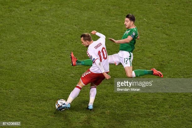 Dublin Ireland 14 November 2017 Christian Eriksen of Denmark has a shot on goal despite a tackle by Stephen Ward of Republic of Ireland during the...