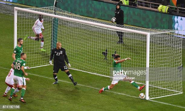 Dublin Ireland 14 November 2017 Cyrus Christie of Republic of Ireland fails to keep out a shot by Andreas Christensen of Denmark during the FIFA 2018...