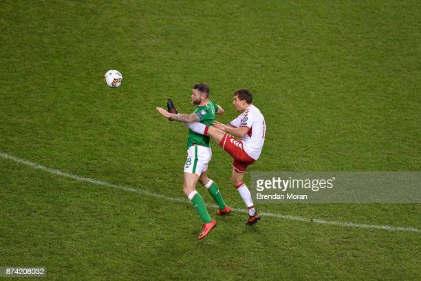 Dublin Ireland 14 November 2017 Daryl Murphy of Republic of Ireland in action against Andreas Bjelland of Denmark during the FIFA 2018 World Cup...