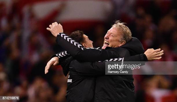 Dublin Ireland 14 November 2017 Denmark manager Aage Hareide right and assistant manager Jon Dahl Tomasson celebrate their side's fourth goal the...
