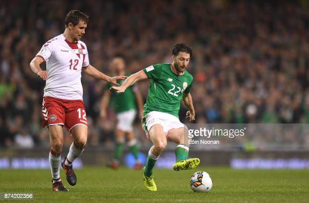Dublin Ireland 14 November 2017 Harry Arter of Republic of Ireland in action against Andreas Bjelland of Denmark during the FIFA 2018 World Cup...