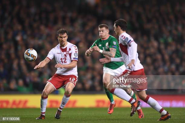 Dublin Ireland 14 November 2017 James McClean of Republic of Ireland in action against Andreas Christensen right and Andreas Bjelland of Denmark...