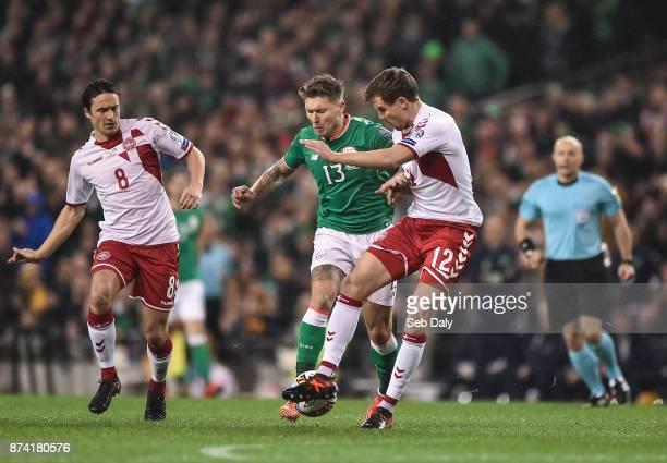 Dublin Ireland 14 November 2017 Jeff Hendrick of Republic of Ireland in action against Thomas Delaney of Denmark and Andreas Bjelland of Denmark...