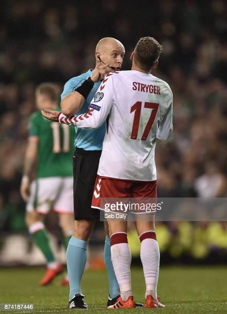 Dublin , Ireland - 14 November 2017; Referee Szymon Marciniak talks to Jens Stryger Larsen of Denmark during the FIFA 2018 World Cup Qualifier...