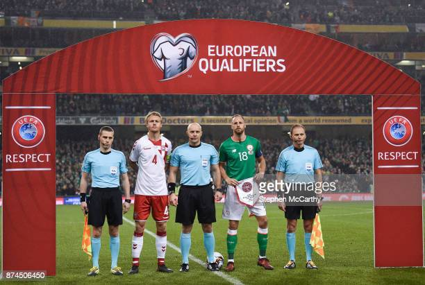 Dublin , Ireland - 14 November 2017; Referee Szymon Marciniak with Denmark captain Simon Kjær and Republic of Ireland captain David Meyler prior to...