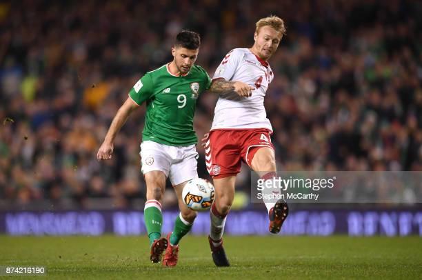 Dublin Ireland 14 November 2017 Shane Long of Republic of Ireland in action against Simon Kjær of Denmark during the FIFA 2018 World Cup Qualifier...