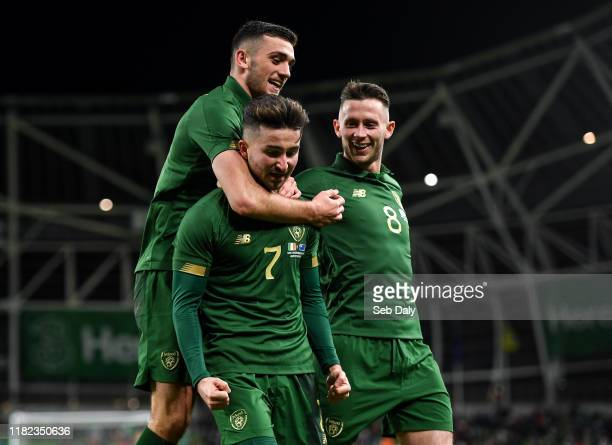 Dublin Ireland 14 November 2019 Sean Maguire of Republic of Ireland centre is congratulated by teammate Troy Parrott left and Alan Browne after...