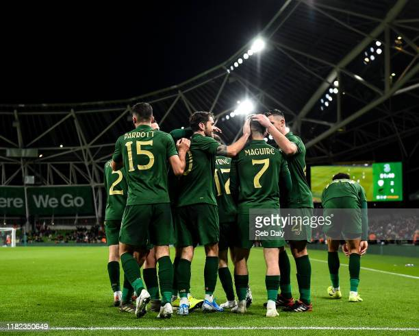 Dublin Ireland 14 November 2019 Sean Maguire of Republic of Ireland is congratulated by teammates after scoring his side's second goal during the...