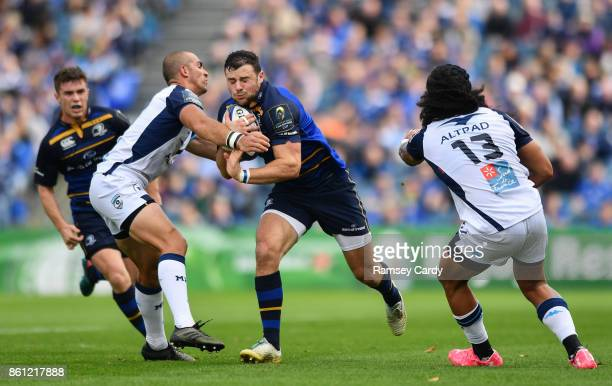 Dublin Ireland 14 October 2017 Robbie Henshaw of Leinster is tackled by Ruan Pienaar of Montpellier during the European Rugby Champions Cup Pool 3...