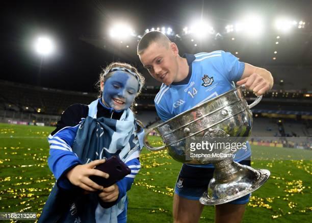 Dublin , Ireland - 14 September 2019; 10-year-old Dublin supporter Grace Dorman with Con O'Callaghan of Dublin following the GAA Football All-Ireland...