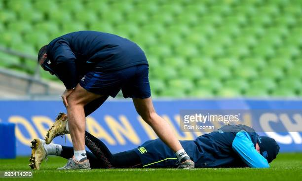 Dublin Ireland 15 December 2017 Jonathan Sexton is assessed by Leinster head physiotherapist Garreth Farrell during the Leinster captain's run at the...